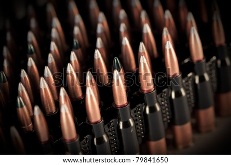 a lot of machine gun bullets on the black background - stock photo