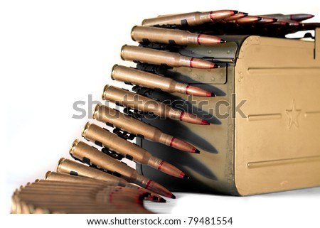 a lot of machine gun bullets on the white background - stock photo