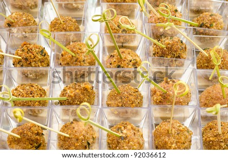 a lot of meat balls on buffet table, catering - stock photo
