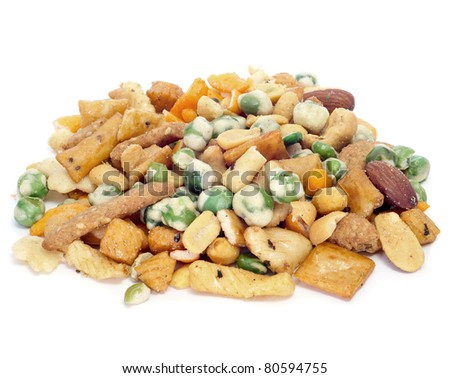 lot of mixed nuts and salty crackers on a white background - stock ...