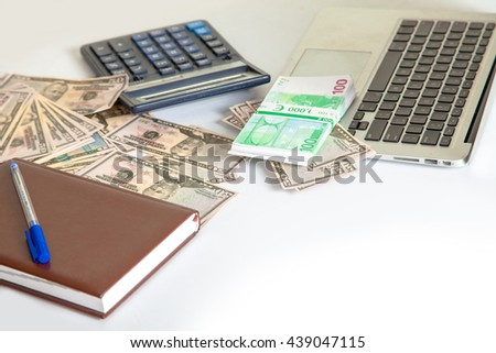 a lot of money dollar and euro lie on the white table with calculator and laptop - stock photo
