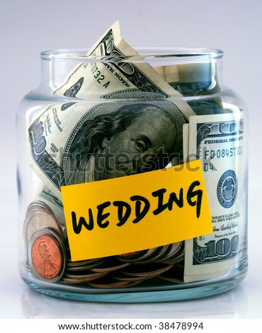 A lot of money in a glass bottle labeled â??Weddingâ?