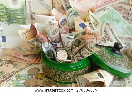 A lot of money in green money box. Various World Currencies - stock photo