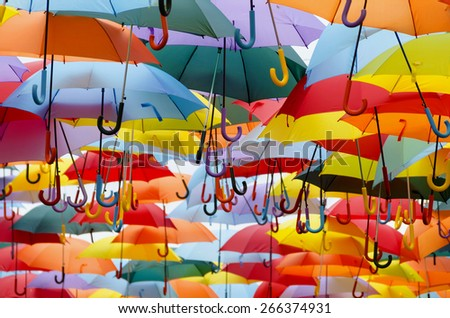 A lot of multicolored umbrellas. Color umbrellas urban decoration.  - stock photo