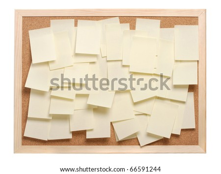 A lot of note papers on a cork board - stock photo