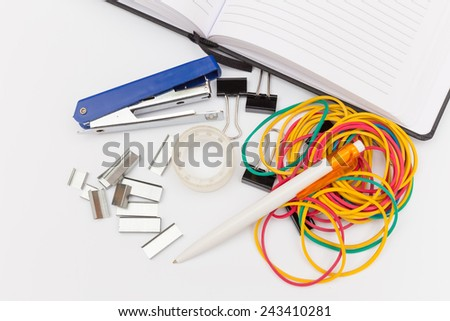 a lot of office supplies on a white background - stock photo
