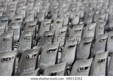 A lot of old and gray chairs