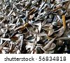 a lot of old forks, spoons and knives - selective focus - stock photo