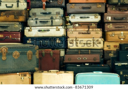 A lot of Old vintage suitcases - stock photo