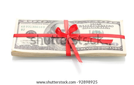 A lot of one hundred dollar bills tied red ribbon isolated on white
