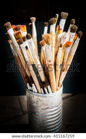 A lot of paint brush  in aluminium can. - stock photo