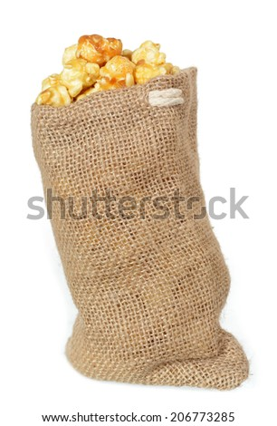 a lot of popcorn and burlap on white