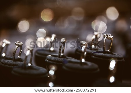 A lot of rings in jewelry window display