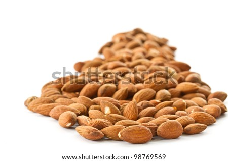 a lot of roasted peeled almonds on a white background