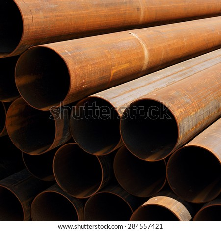 a lot of rusty pipes close-up perspective - stock photo