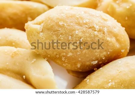 a lot of salty peanuts macro - stock photo