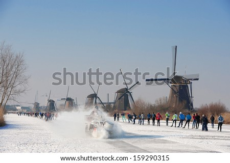 a lot of skaters have fun by the mill tour at Kinderdijk - stock photo