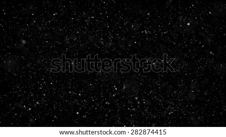 a lot of small shiny particles with different scale covered dark background - stock photo