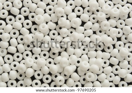 a  lot of small white  beads on plane - stock photo