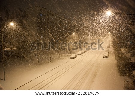 a lot of snowfall and empty road