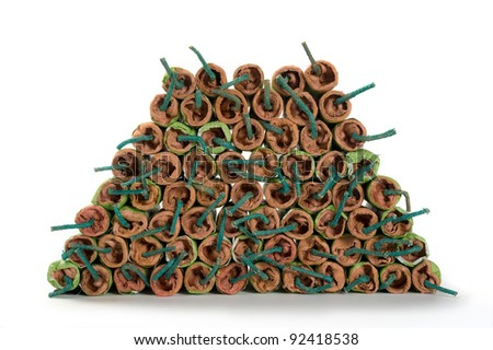 A lot of stacked firecrackers with green fuse - stock photo