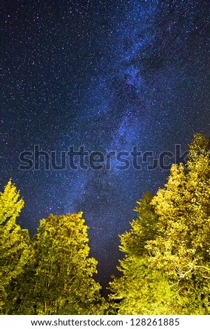 A lot of stars and the milky way seen from Plitvice national park in Croatia, a UNESCO world heritage site - stock photo