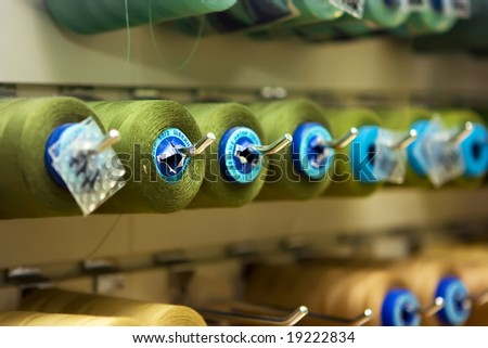 A lot of thread spools attached to a wall - stock photo