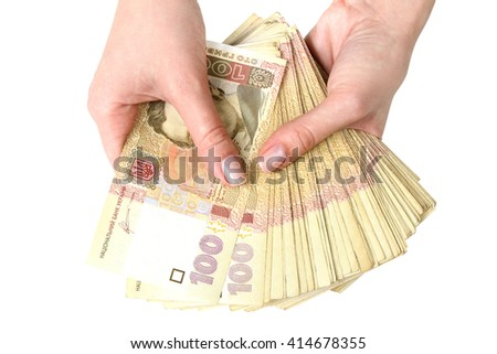 a lot of Ukrainian banknotes in the hands of women isolated on white background