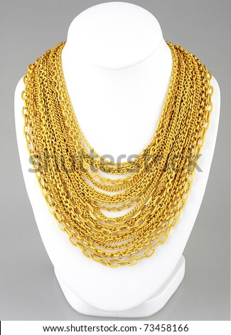 a lot of valuable gold necklace - stock photo
