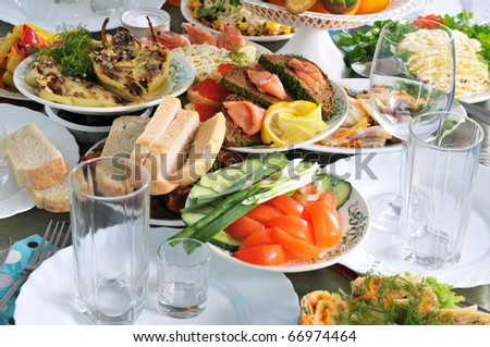 A lot of various meal on a banquet table. - stock photo