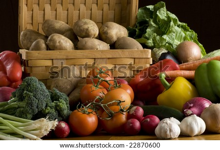 A lot of vegetables on dark background - stock photo