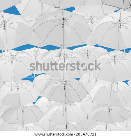 A lot of white umbrellas. White umbrellas urban decoration.  - stock photo