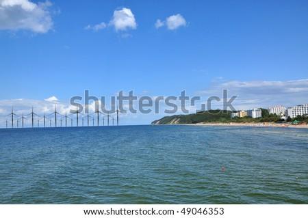 A lot of windmill at the sea coast - stock photo