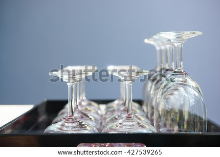 a lot of wine glasses in restaurant, empty