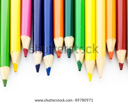 A lot of wooden pencils on a light background. - stock photo