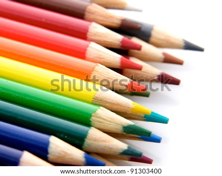 A lot of wooden pencils on a light background - stock photo