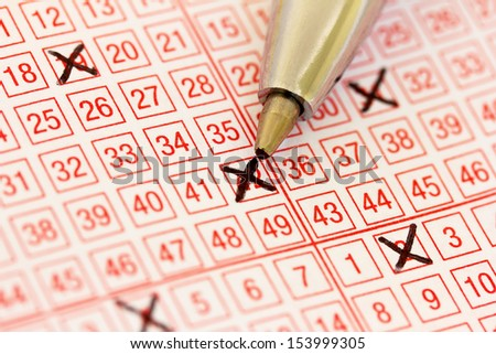 a lottery ticket with ticked numbers - stock photo