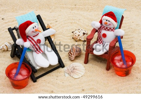 A lounge chair with snowmen on a sand background, Relaxing on your winter vacation - stock photo