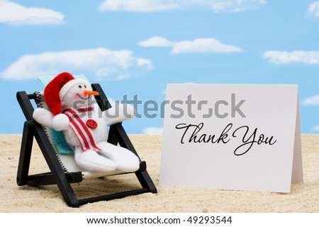A lounge chair with snowmen on a sky background, Thankful for Vacation Time - stock photo