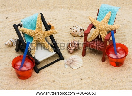 A lounge chair with starfish on a sand background, Having fun on vacation - stock photo