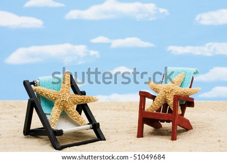 A lounge chairs with starfishes on a sky background, Relaxing on Vacation - stock photo