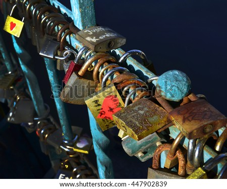 A love lock or love padlock is a padlock which sweethearts lock to a bridge. Bridge Tumski, Wroclaw, Poland - stock photo