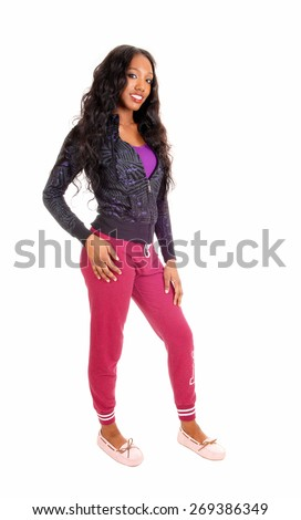A lovely African American woman in a red skirt and black blouse holding