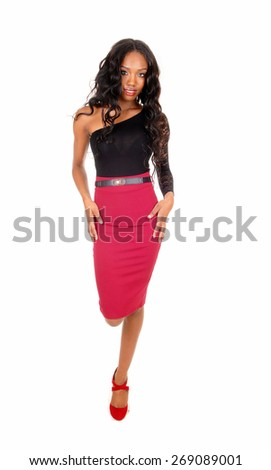 A lovely African American woman in a red skirt and black blouse walking