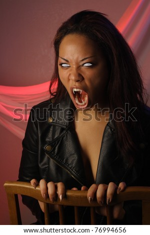 A lovely but scary young multiracial female vampire or monster. - stock photo