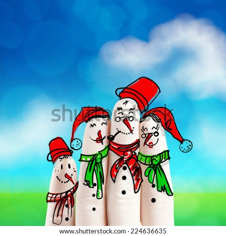 A lovely family hand drawn and finger of snowmen on nature background as concept idea - stock photo