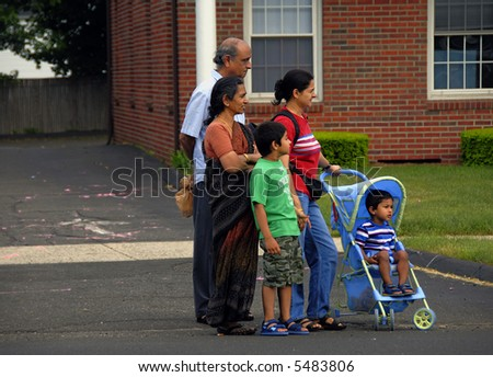 A lovely Indian family waiting on the road - stock photo