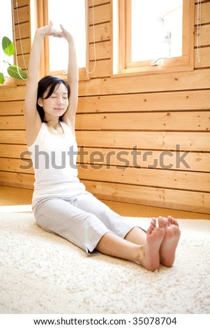 A lovely Japanese woman doing exercises - stock photo
