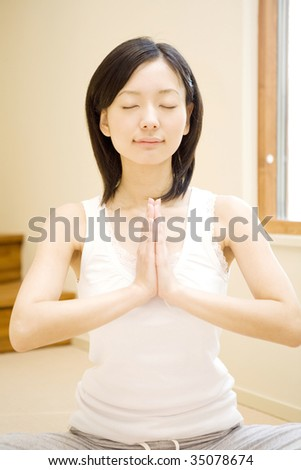 A lovely Japanese woman doing yoga - stock photo