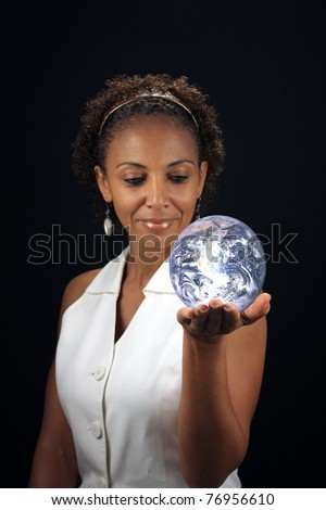 A lovely mature black woman holds the earth in the palm of her hand.  This photo is available without the earth.  Earth photo credit:  NASA, public domain. - stock photo